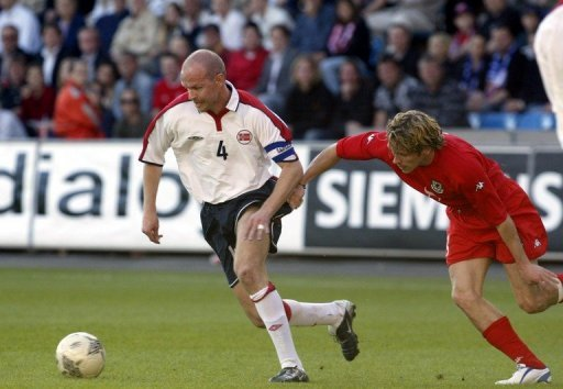 Henning Berg (L) pictured during his playing days in a friendly against Wales in Oslo on May 27, 2004