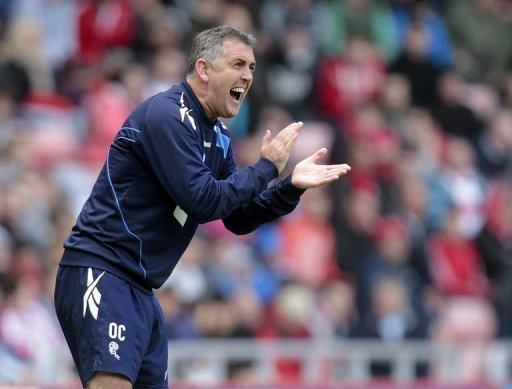 Owen Coyle shouts instructions to his Bolton players during a match against Sunderland on April 28, 2012