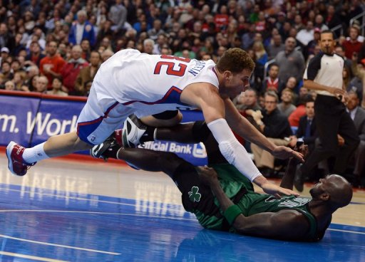 Blake Griffin of the Clippers knocks over Kevin Garnett of the  at Staples Center on December 27, 2012