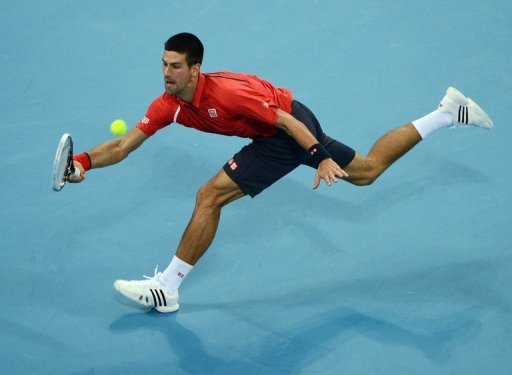 Novak Djokovic reaches for a forehand at the China Open in Beijing on October 2, 2012