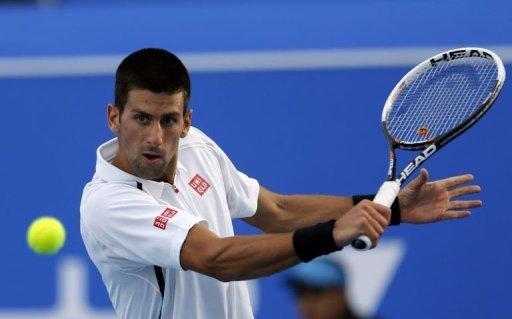 Novak Djokovic returns the ball to Spain's David Ferrer in Abu Dhabi on December 28, 2012.