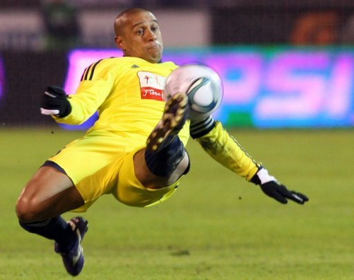 Anzhi Makhachkala's Brazilian defender Roberto Carlos clears the ball during a game in St. Petersburg on March 21, 2011