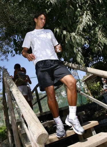 Rafael Nadal attends a trainning session on the Spanish Island of Mallorca, on July 20, 2009
