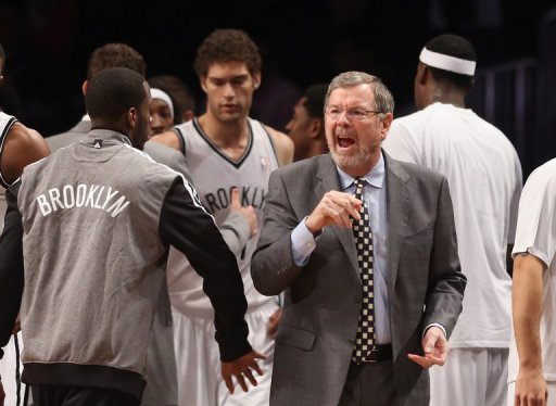 P.J. Carlesimo of the Brooklyn Nets argues with a ref at the Barclays Center on December 28, 2012