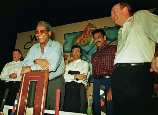 Tony Greig (R) at a cricket memorabila auction at a hotel in south Bombay, on May 16, 1997