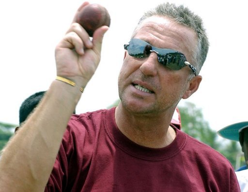 Former England cricket captain Ian Botham coaches Sri Lankan schoolboys during a visit to Galle on April 20, 2005