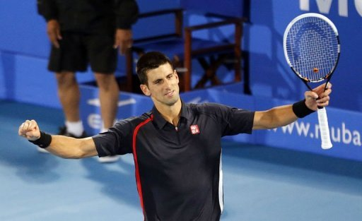 Novak Djokovic celebrates winning the Mubadala World Tennis Championship final in Abu Dhabi on December 29, 2012