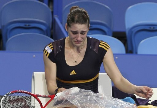 Andrea Petkovic receives treatment to her right knee during a Hopman Cup match in Perth on December 29, 2012