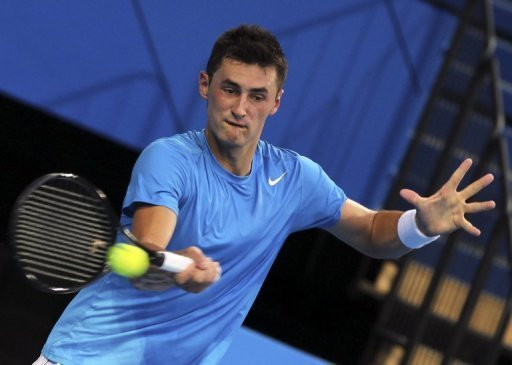 Bernard Tomich hits a return against Tommy Haas during their Hopman Cup tennis match in Perth on December 29, 2012