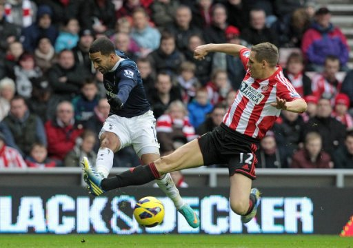 Sunderland's Matthew Kilgallon (R) makes a lunge at Tottenham Hotspur's  Aaron Lennon December 29, 2012