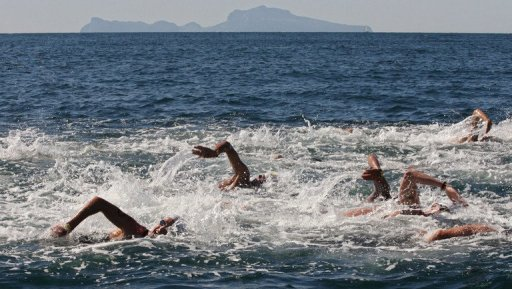 File illustration photo of swimmers competing in an open water race in Italy, on August 31, 2006