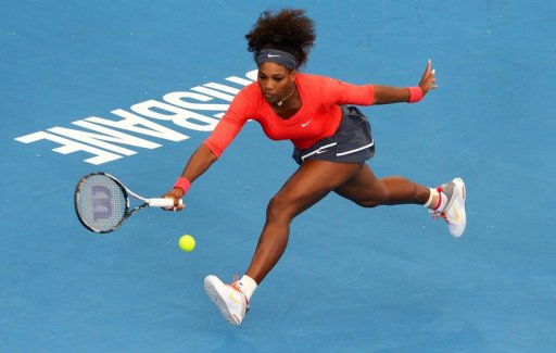 Serena Williams hits a forehand in her first-round match at the Brisbane International on December 30, 2012