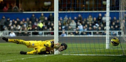 QPR goalkeeper Julio Cesar watches as the ball hits the back of the net for Liverpool's third goal on December 30, 2012