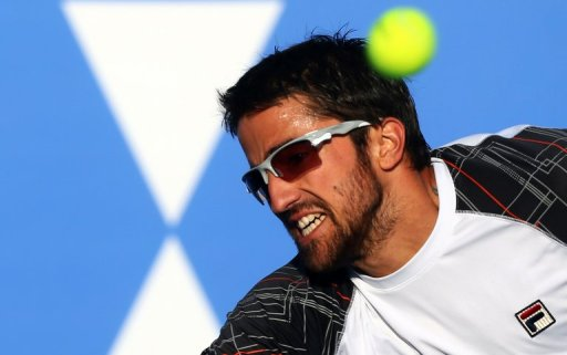 Janko Tipsarevic returns the ball to Spain's David Ferrer in Abu Dhabi on December 29, 2012