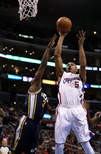 Caron Butler (R) of the Los Angeles Clippers shoots over DeMarre Carroll of the Utah Jazz, on December 30, 2012
