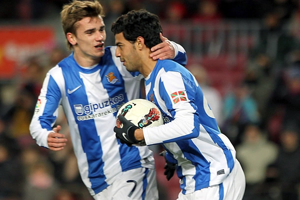 Carlos Vela helped Real Sociedad add to Sevilla's misery