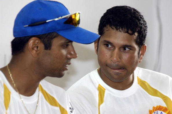 Indian cricketer Rahul Dravid (L) speaks