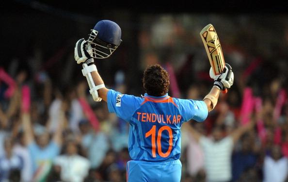 India cricketer Sachin Tendulkar raises