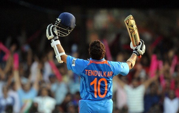 India cricketer Sachin Tendulkar raises
