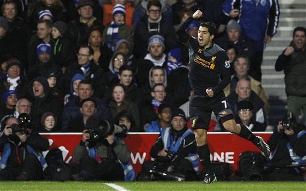 Luis Suarez celebrating his first goal against QPR.