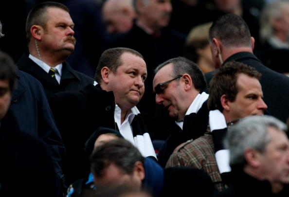 Newcastle owner Mike Ashley (l) chats to managing director Derek Llambias during the Barclays Premier League match