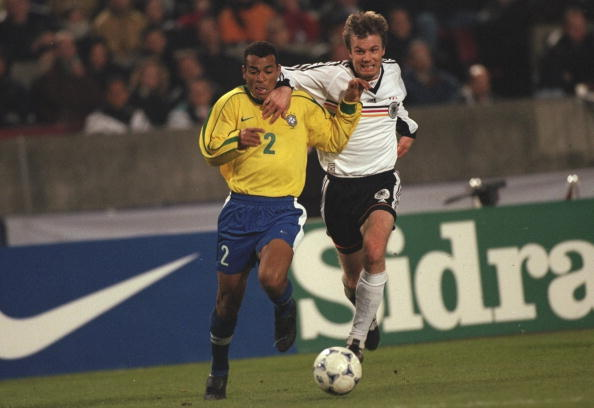 Cafu of Brazil fights off Thomas Helmer of Germany