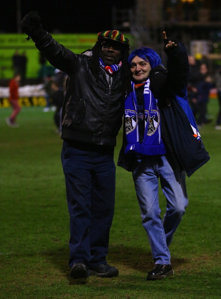 OLDHAM, ENGLAND - JANUARY 27:  Oldham fans celebrate victory at the end of the FA Cup with Budweiser Fourth Round match between Oldham Athletic and Liverpool