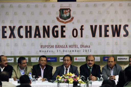 Bangladesh Cricket board President Nazmul Hasan (centre) addresses journalists in Dhaka on December 31, 2012