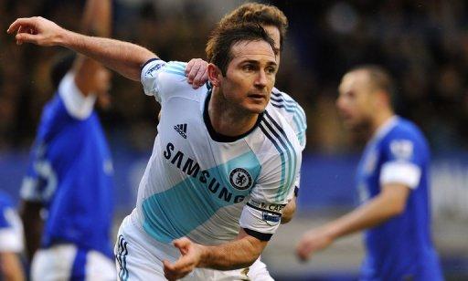 Chelsea midfielder Frank Lampard scores against Everton at Liverpool's Goodison Park on December 30, 2012