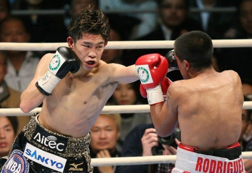 Japan's Kazuto Ioka (L) fights Jose Rodriguez of Mexico in Osaka on December 31, 2012