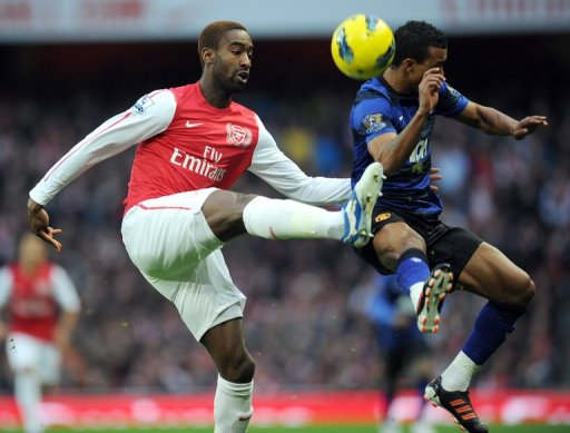 Arsenal's Johan Djourou (left) and Manchester United's Patrice Evra , January 22, 2012 at the Emirates Stadium in London