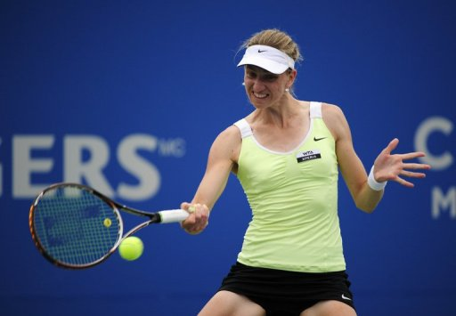 Mona Barthel returns to Agnieska Radwanska of Poland during a Rogers Cup match in Montreal on August 9, 2012