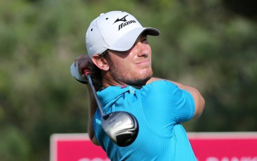 England's Chris Wood plays a shot during the third round of the Qatar Masters golf tournament in Doha, January 25, 2013