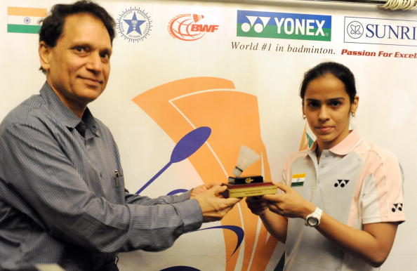 "Saina Nehwal receives the ""Eddy Choong"" Most Promising Player-2008 Award from the president of the Badminton Championship 2009, V.K.Verma during the unveiling of the Yonex Sunrise World Badminton Championship."