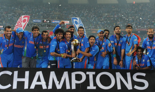 Indian cricketers pose with the trophy a