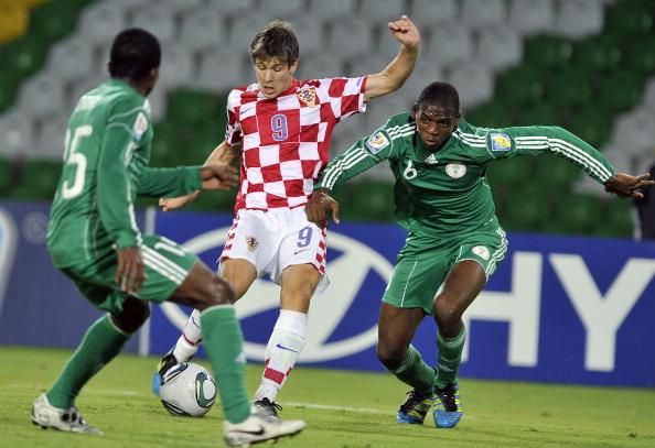 Croatia´s Andrej Kramaric (C) is marked
