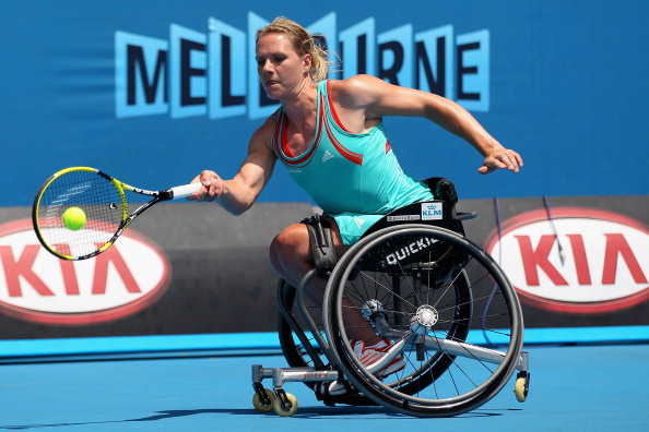MELBOURNE, AUS - JAN 28, 2012: Esther Vergeer plays a forehand in her Women's Wheelchair singles final match against Aniek Van Koot  at 2012 Australian Open at Melbourne Park. She missed this year's Open.