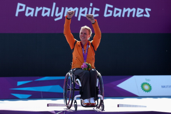 LONDON, ENGLAND - SEPTEMBER 07:  Esther Vergeer of Netherlands with her gold medal after defeating Aniek Van Koot of Netherlands in the final of the Women's singles match in the Wheelchair Tennis on day 9 of the London 2012 Paralympic Games at Eton Manor on September 7, 2012 in London, England.
