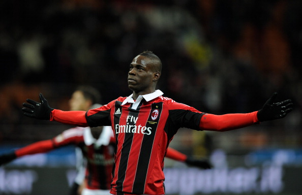 MILAN, ITALY - FEBRUARY 03:  Mario Balotelli of AC Milan celebrates after scoring his second goal from the penalty spot against Udinese.