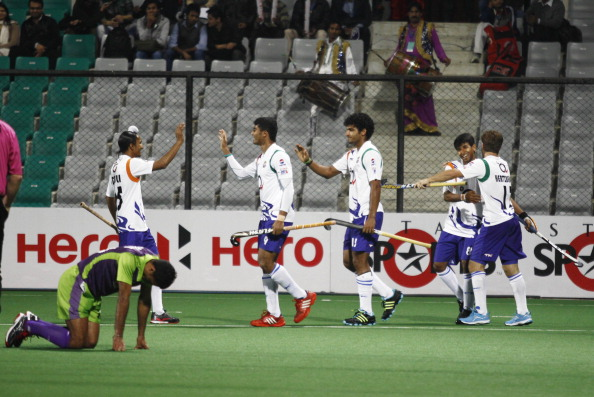 NEW DELHI, INDIA - FEBRUARY 7: UP Wizards players celebrates a goal against Delhi Waveriders during Hockey India League match at Major Dhyan Chand Stadium on February 7, 2013 in New Delhi, India.
