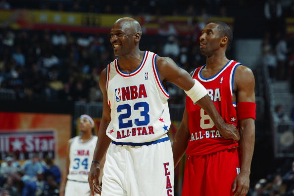 Michael Jordan (Washington Wizards) #23 of the Eastern Conference All-Stars jokes with Kobe Bryant (Los Angeles Lakers) #8 of the Western Conference All-Stars during the 2003 NBA All-Star Game on February 9, 2003 at Philips Arena in Atlanta, Georgia.