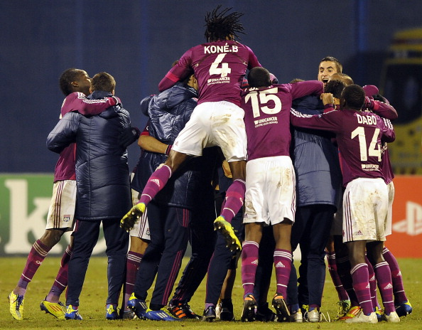 Lyon's players celebrate after their gro