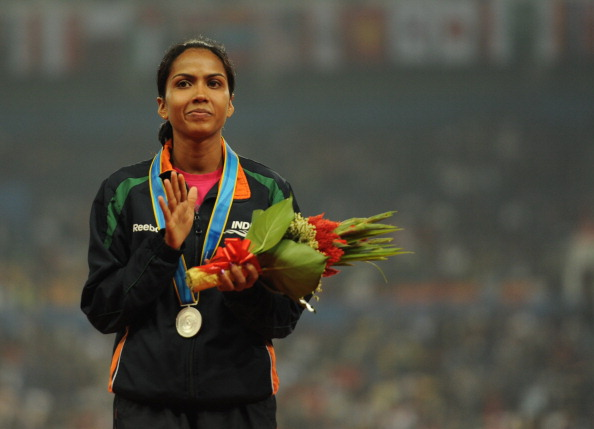 Kavita Raut of India celebrates on the p