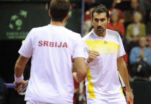 Serbia's Viktor Troicki (L) and Nenad Zimonjic play doubles against Belgium on February 2, 2013 in Charleroi