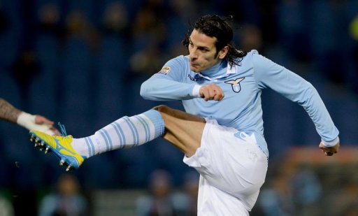 Lazio's forward Sergio Floccari kicks to score on February 9, 2013 at Rome's Olympic stadium
