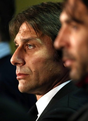 Juventus coach Antonio Conte gives a press conference, on February 11, 2013, ahead of the last-16 clash at Celtic