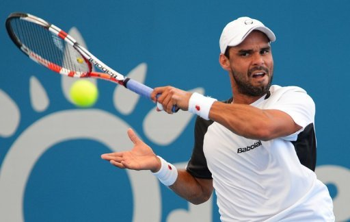 Alejandro Falla hits a forehand return during his match against Gilles Simon on January 2, 2013