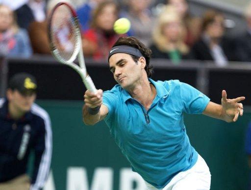 Swiss player Roger Federer returns a ball to France's Julien Benneteau in Rotterdam on February 15, 2013