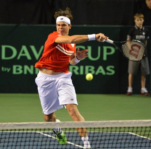 Milos Raonic plays a return during a Davis Cup tie in Vancouver on February 1, 2013