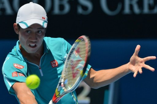 Kei Nishikori hits a return to David Ferrer during their match at the Australian Open on January 20, 2013